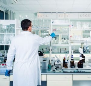 scientist in laboratory with monitoring system